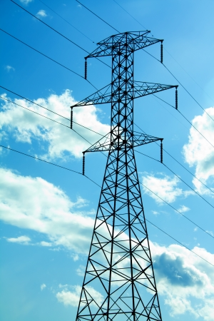 power lines against a blue sky with clouds Stock Photo