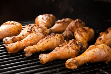 roasting: Chicken drumsticks on the grill Stock Photo