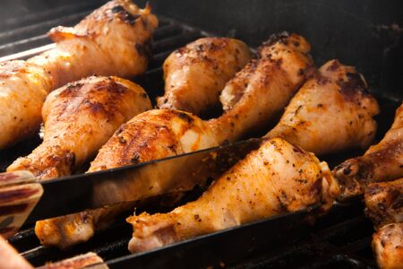 Chicken drumsticks on the grill Stock Photo