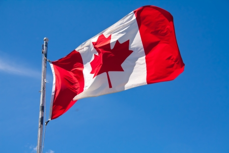 The Canadian flag, flapping in the wind Stock Photo