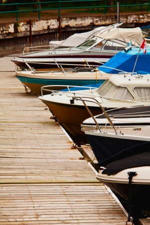 5 boats docked in the harbour Editorial