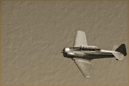 a vintage fighter plane on a sepia background Editorial
