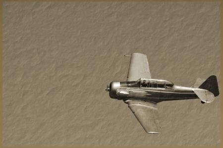 a vintage fighter plane on a sepia background Редакционное