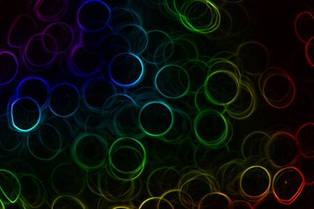 Abstract Neon rainbow colored rings on a black background Stock Photo - 14983734