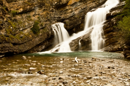 Smooth Waterfall in a rocky canyon Stock Photo