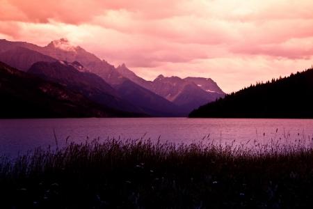 Mountain sunset on the lake Фото со стока