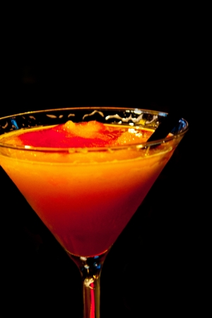 an orange Bellini alcoholic drink on a black background Stock Photo