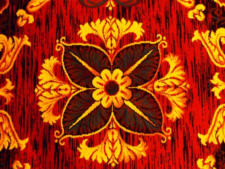 a bright red and yellow pattern with texture