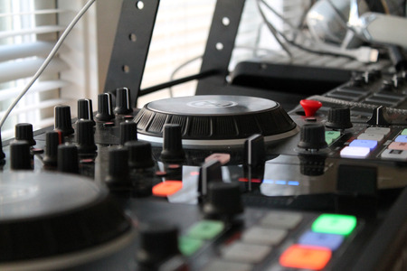 turntables: Close up of turntables with glowing switches Stock Photo