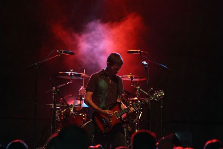 Blues Guitarist Haloed In Red Concert Lighting