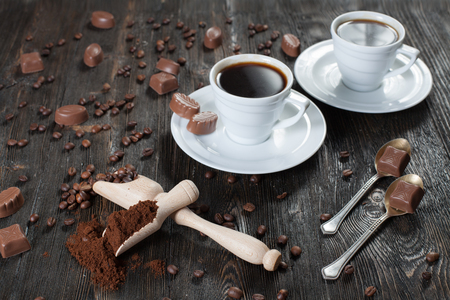 Ground coffee and coffee beans in a wooden bowl