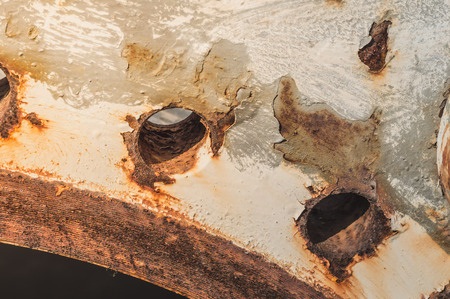 Old and rusty steel pipe fitting,Big Pipes at scarp yard.Old Flanges,Flanges pipe with nuts and bolts. Pipeline for oil industry.