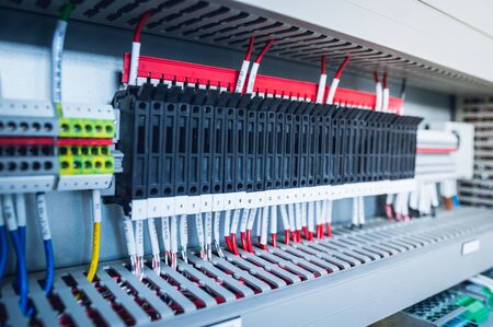 Wiring PLC Control panel with wires industrial factory.Wiring terminals in the electrical Cabinet. Electrical wires or cables are connected to electrical equipment