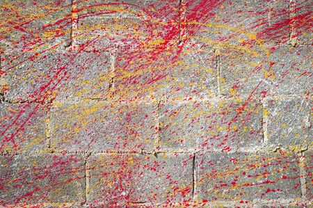 Concrete block wall background and texture.Colorful Concrete block wall as background,color painting on concrete  block  wall .Dropping acrylic paint on the concrete wall.