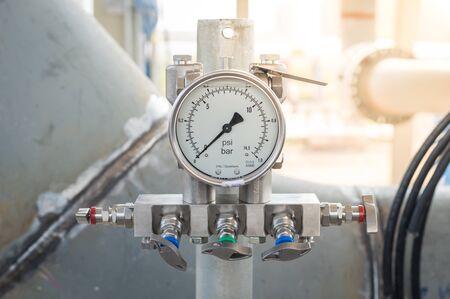 Pressure differential gauge,Pressure gauge, measuring instrument close up on pneumatic control system.