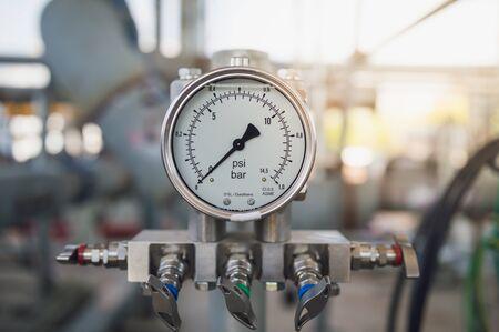 Pressure gauge, measuring instrument close up on pneumatic control system. Banco de Imagens - 139269114