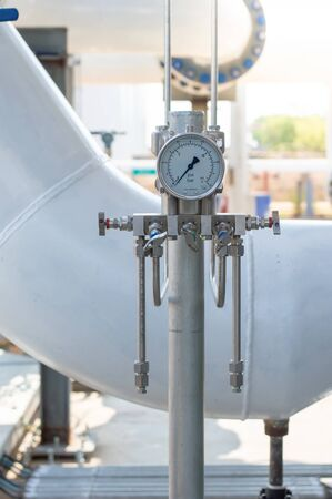 Pressure differential gauge,Closeup of manometer, measuring gas pressure. Pressure gauge, measuring instrument close up on oil and gas pipeline.