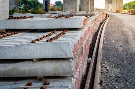 Background and Texture of piled concrete sleeper at train station.Pile of precast concrete sleepers ready for construction in trackwork.Sleepers made of concrete laid in a row for rails.