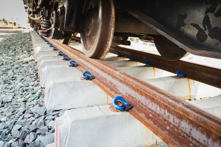 New railroad tracks with concrete railway sleepers and clip.Steel railway for trains.Train Track Bar hold E-Clip /Clip,iron material on the cement chock. Banco de Imagens