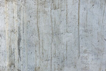 Concrete expose surface for background.Abstract textured cement concrete gray background and wallpaper.Gray blank concrete cement textured background and wallpaper for text and photo. Banco de Imagens - 139183993