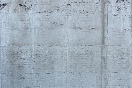 Concrete expose surface for background.Abstract textured cement concrete gray background and wallpaper.Gray blank concrete cement textured background and wallpaper for text and photo.