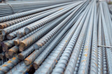 Construction rebar steel work reinforcement in conncrete structure of building.Background texture of steel rods used in construction to reinforce concrete