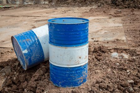 Industry oil barrels or chemical drums stacked up.Stack Of Oil barrels in plant.Oil drums waste.stack of grunge drums