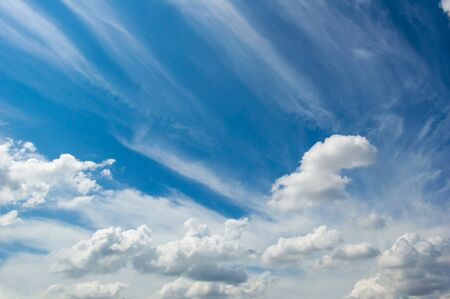 Abstract white fluffy clouds and  Blue sky in sunny day background.Natural Celestial World  concept with blue sky and clouds  Use as background. Banco de Imagens