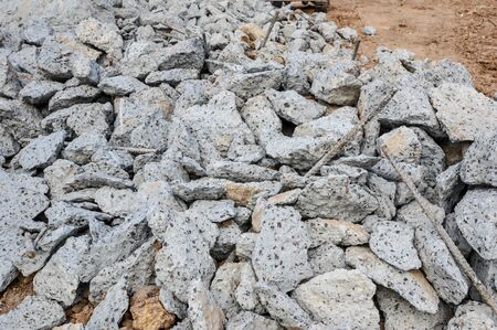 Pile of Concrete debris on construction site after a demolition of a  building or  road.Construction waste recycling.