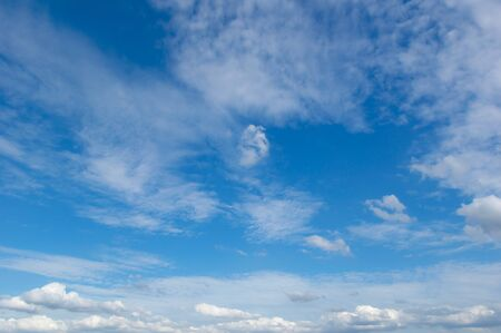 Abstract white fluffy clouds and  Blue sky in sunny day background.Natural Celestial World  concept with blue sky and clouds  Use as background. Banco de Imagens - 142694411