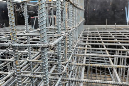 Reinforcing steel column for building,Construction work.Rebar steel bars, reinforcement concrete bars with wire rod used in construction site.Using steel wire for securing steel bars with wire rod for