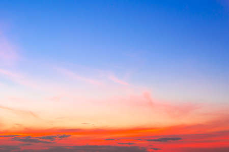 Beautiful sky painted by the sun leaving bright golden shades.Dense clouds in twilight sky in winter evening.Image of cloud sky on evening time.Evening sky scene with golden light from the setting sun Standard-Bild