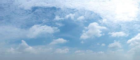 blue sky background with tiny clouds. panorama white fluffy clouds in the blue sky.Beautiful vast blue sky with amazing cloud background.Wide sky panorama with scattered cumulus clouds.