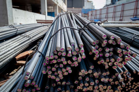 Construction steel rods or bars work reinforcement in conncrete structure of building.Background texture of steel rods used in construction to reinforce concrete