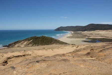 Te Werahi Beach and Cape Reinga as seen from the clay hills in Northland, New Zealand. Stock Photo