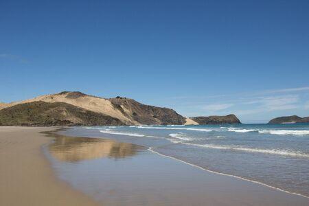 The remote Te Werahi Beach and Cape Maria Van Dieman.on the Cape Reinga in Northland, New Zealand.