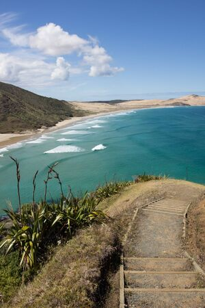 Stairs leading to Te Werahi Beach and Cape Maria Van Diemen in Cape Reinga in Northland, New Zealand Stock Photo - 136910518