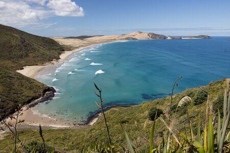 Blue waters of Te Werahi Beach and Cape Maria Van Diemen on Cape Reinga, Northland, New Zealand. Stock Photo