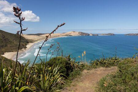 Te Paki Coastal Track to Te Werahi beach and Cape Maria Van Diemen, Cape Reinga, New Zealand. Stock Photo - 136910568