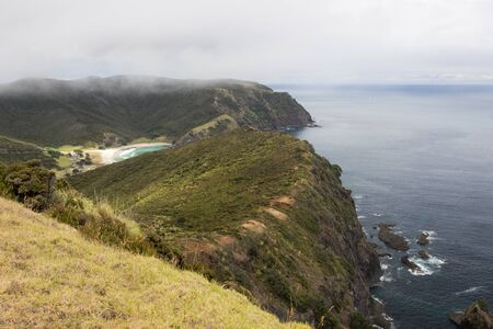 The Te Paki Coastal Track on the Cape Reinga in Northland, New Zealand, with Tapotupotu Bay beyond. Stock Photo