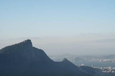 Late afternoon blue sky view of Mirante Dona Marta and Christ the Redeemer statue on Corcovado mountain in the Tijuca Forest, from Morro Dois Irmaos Two Brothers Hill, in Rio de Janeiro. Stock Photo