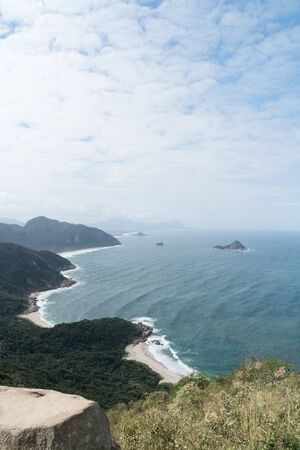 View from Pedra do Telegrafo rock, overlooking the pristine Praias Selvagens ,Wild Beaches, outside of the city of Rio de Janeiro. Where tourists take dangerous looking photos on a high rock.