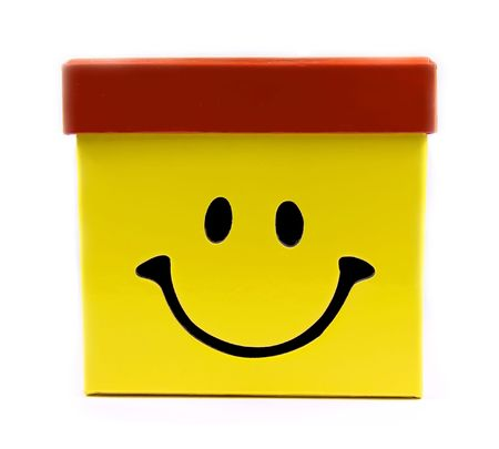 Yellow gift box with big smile and red cap.