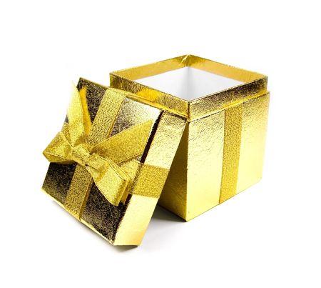 Opened golden shining gift box isolated on white.