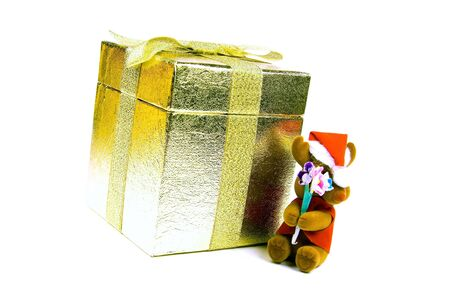Small reindeer by golden gift box. photo