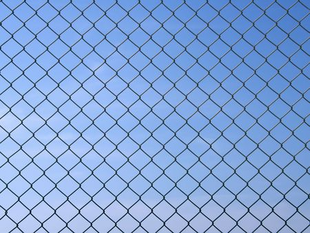 enmesh: Metal grid - texture. Shot over blue sky. Stock Photo