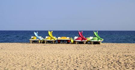 Pedalos on the beach Stock Photo