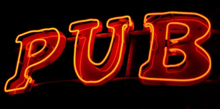 Photo of a neon light sign saying Pub