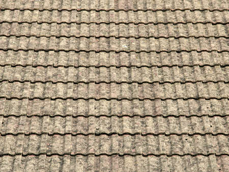 rooftile: view of a roof with gray tiles structure