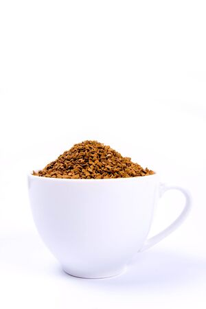 granules: Coffee granules in a white cup isolated. Stock Photo